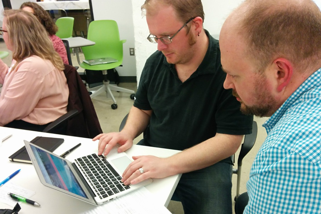 Refresh Detroit members RJ and Randy Walker using he VoiceOver screen reader